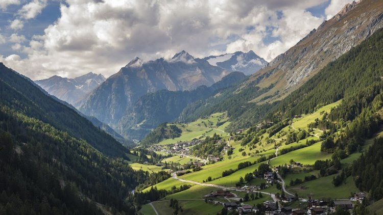 Mountains, green pastures and clouds