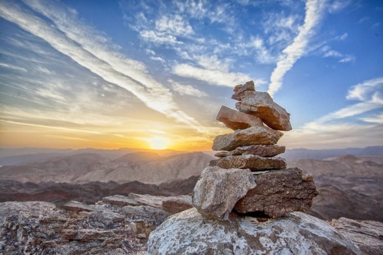 Stack of rocks seen at sunset, Break the Routine and Add Adventure to your Life