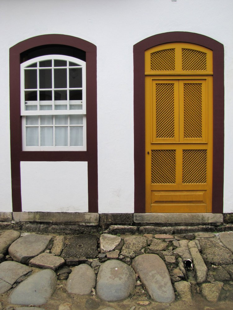 Yellow and red door (and window) in Paraty, Rio de Janeiro (Brazil)
