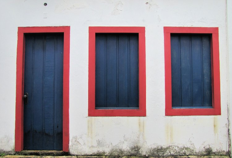 Blue and red doors and windows in Paraty, Rio de Janeiro (Brazil)
