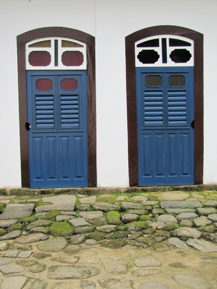 Two blue and brown doors in Paraty, Rio de Janeiro (Brazil)