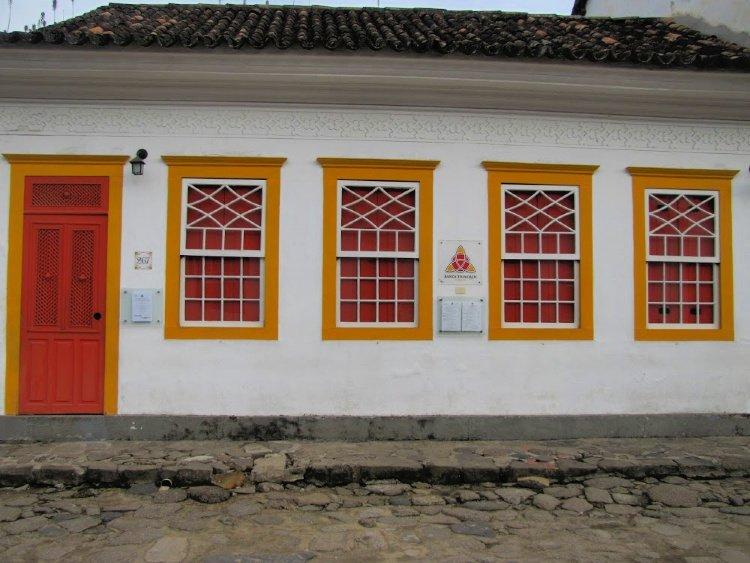Orange door and windows in Paraty, Rio de Janeiro (Brazil)