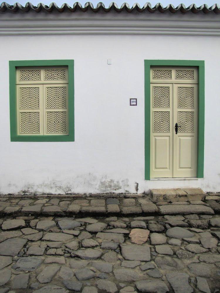 Cream and green door in Paraty, Rio de Janeiro (Brazil)