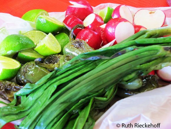 Jalapenos, radishes, green onions and limes served with food