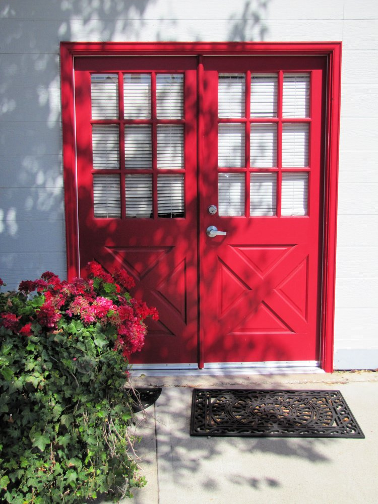 Red door and matching red flowers at Solvang, California