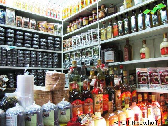 Mole and other goods for sale in the Mercado Benito Juarez, Oaxaca, Mexico