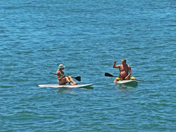 Taking a break from paddleboarding, Malibu, California