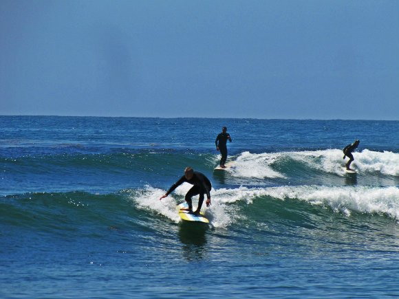 Surfers riding the waves, Surfrider Beach or Malibu Creek Satte Beach, Malibu, California
