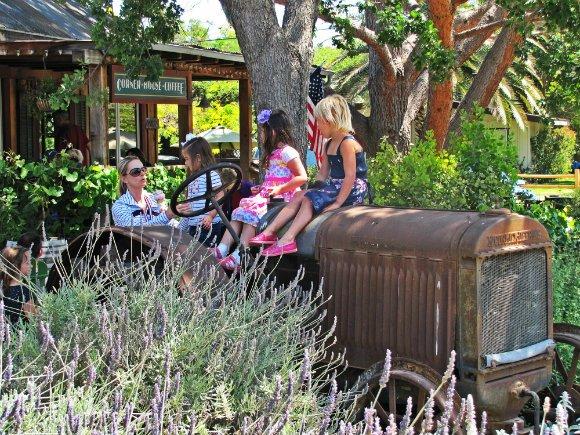 Kids playing at old car, Los Olivos, California