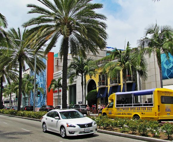 Tour bus driving thru Rodeo Drive, Beverly Hills, California