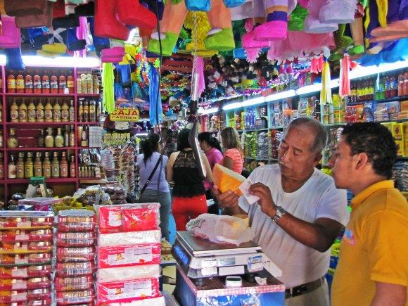 Checking the cheese, Mercado Hidalgo, Tijuana, Mexico