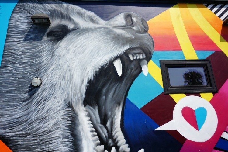 One Day in LA, Bear Witness mural located on one side of Greenleaf Gourmet Chopshop in Aboout Kinney Boulevard, Vemice Beach, California