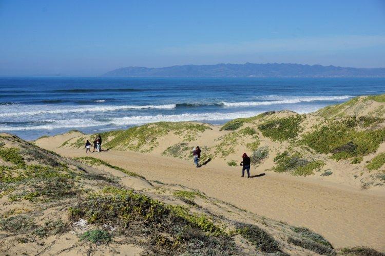 Sand dunes and San Luis Obispo Bay at Oso Flaco Lake, California