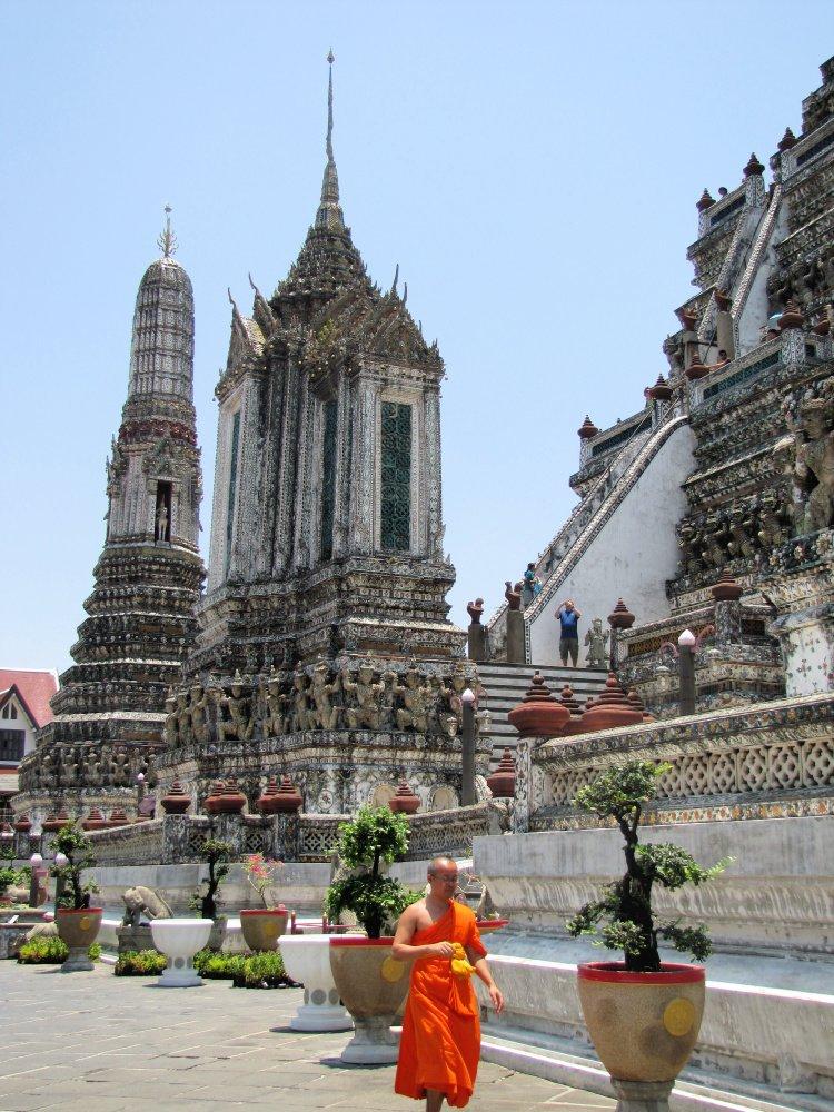 Monk walking around Wat Arun, the temple of dawn, Bangkok, Thailand