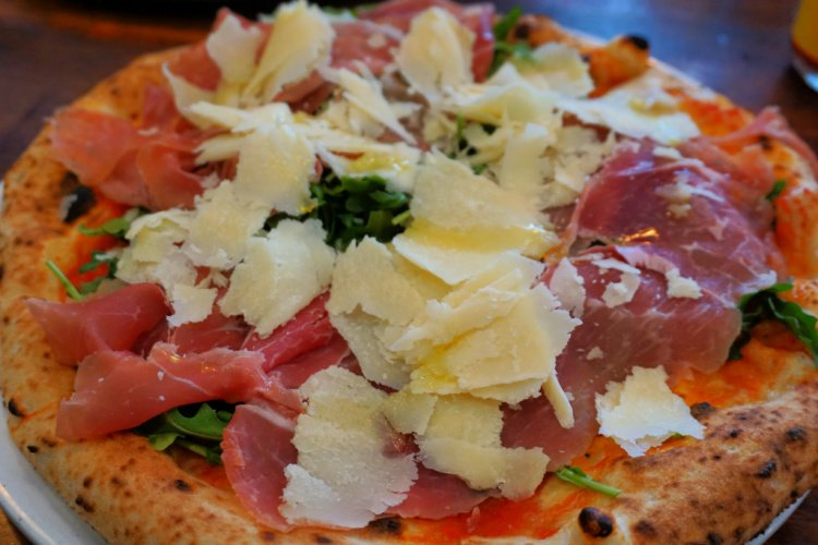 Arugula, prosciutto and Parmesan pizza in North Beach, San Francisco, California