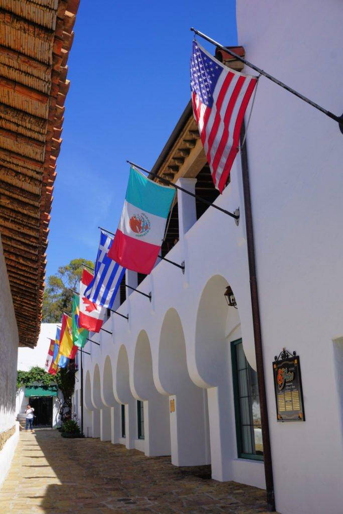 Row of flags near Casa de la Guerra, Santa Barbara, California