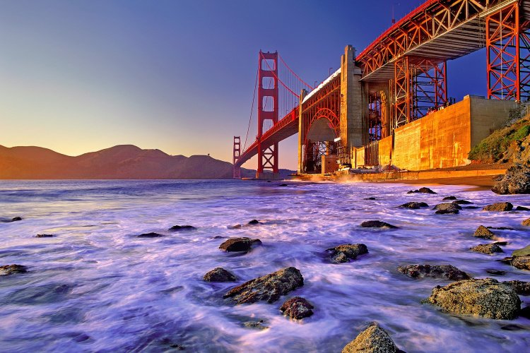 Planning a Trip to California, Golden Gate Bridge bathed in sunset light, San Francisco