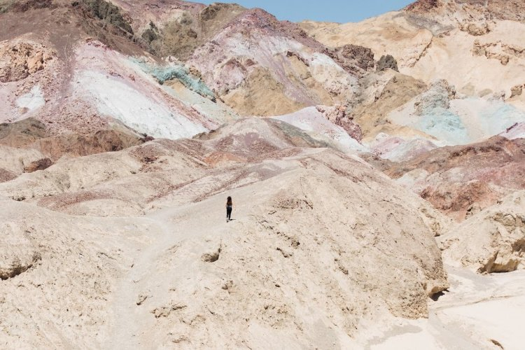 Person walking around the Artist's Palette in Death Valley