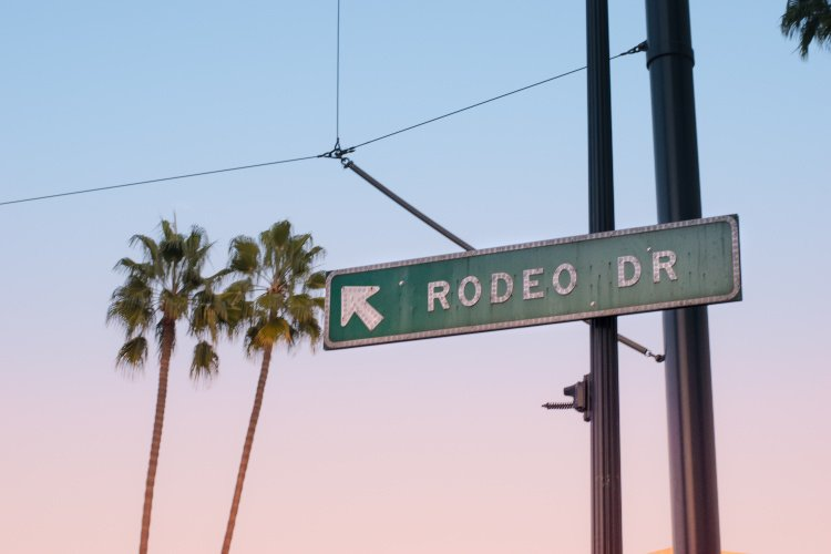 Rodeo drive sign at sunset